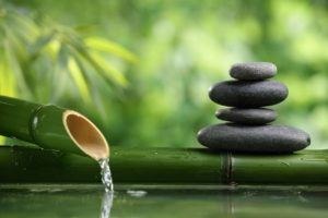 Rocks balancing, and water inside bamboo